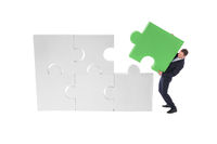 Business man assembling puzzle