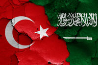 flags of Turkey and Saudi Arabia painted on cracked wall