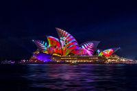 Sydney Opera House illuminated with beautiful vibrant imagery at night