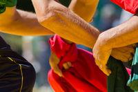 Hands of men in the struggle of national wrestling kuresh at sunny day