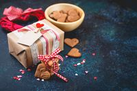 Gift box with and cookies in the shape of heart.