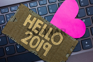 Conceptual hand writing showing Hello 2019. Business photo text Hoping for a greatness to happen for the coming new year Paperboard Romantic lovely message Heart Keyboard Type computer.