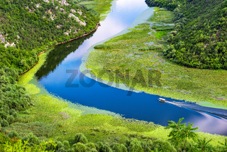 Boat on river in mountains