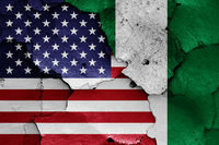 flags of USA and Nigeria painted on cracked wall