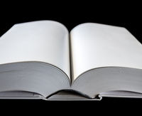 Open blank dictionary, book on black background