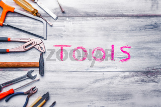 Industry toolkit and written tools close up