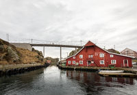 Rovaer in Haugesund, Norway - januray 11, 2018: The Rovaer archipelago in Haugesund, in the norwegian west coast. The bridge between the two islands Rovar and Urd. The red hostel by the sea.