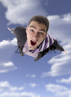 Winged businessman flying through the sky