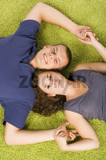 young couple on green carpet