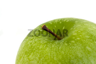 detail of a granny smith  apple isolated on white background