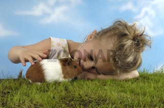 Child with Guinea Pig / Kind mit Meerschweinchen