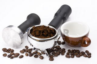 espresso cup, beans and details of the machinery