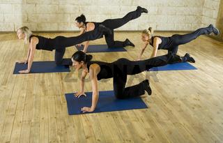 Stretching exercise on yoga mat