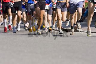 runners feet on asphalt
