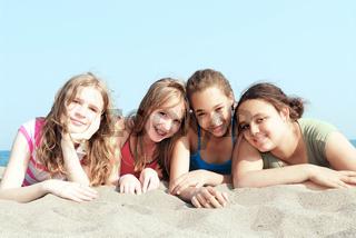 Four girls on a beach