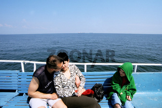 Ukraine, Odessa, parents with son (10-11) on ferry boat