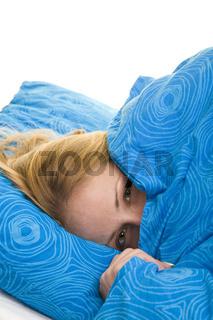 Unter der Bettdecke verkriechen