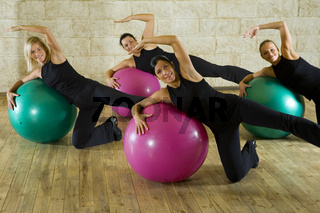 Stretching exercise on fitness ball
