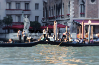 Canale Grande Grand Canal and gondola ride, Gondoliers, gondolas and tourists, stone statue in background, Venice, Italy (blurre