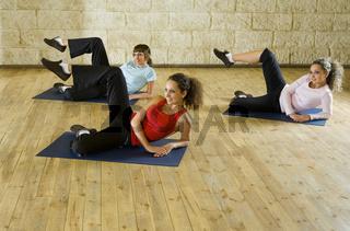 Young women exercising on mat