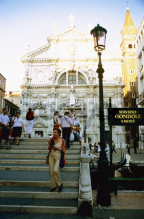 San Marco San Moise, Tourists on stone steps, church in background, Venice, Italy