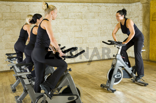 Group of women exercising on bikes