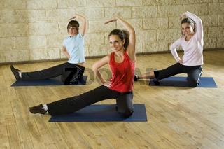 Stretching exercises on yoga mat