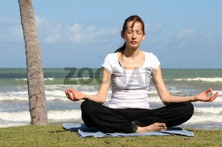 Meditieren auf dem Strand