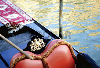 Gondola detail Canale Grande Grand Canal, Gondola seat with ornate detail, water in background, (close up), Venice, Italy