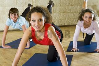 Women exercising on yoga mat