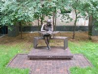 Bronze sculpture of a student sitting at his desk, in patio of the Moscow State Linguistic University