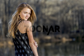 Young Blonde Teenager Enjoys A Beautiful Day