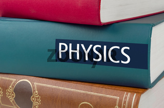 A book with the title Physics written on the spine