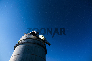 Astronomical Observatory under the night sky stars