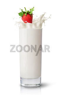 Strawberry falling into milk