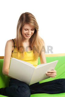 Smiling young blond woman with book