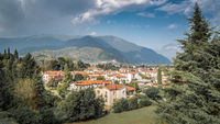 Bassano del Grappa with mediteran style houses and hills in the background Alpini in Vicenza, Italy
