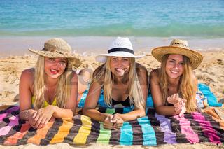 Three dutch girls sunbathing on beach