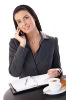 Businesswoman working at coffee break