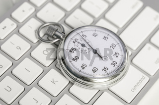 Close up of analog stopwatch on keyboard