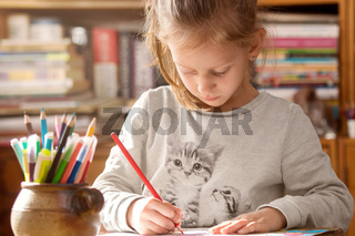 Girl coloring in a coloring book