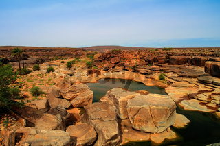 Panorama of rocky pond on Adrar plateau Mauritania