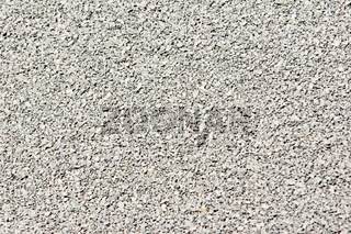 Feiner grauer Straßensplitt als Nahaufnahme