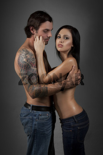 Portrait of a sexual couple. Shot in a studio.