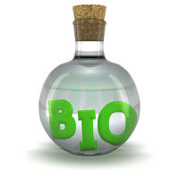 Green word BIO in the bottle with organic liquid