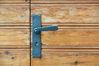Old wooden door and door handle with lock