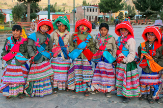 Boys in traditional costumes standing at the main square in Yanque town in Colca Canyon, Peru