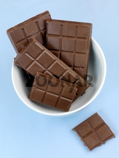 Packaged cooking chocolate isolated against a blue background