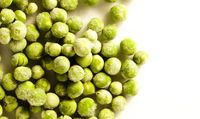 Frozen Peas on white surface