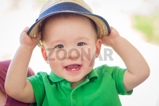 Portrait of A Happy Mixed Race Chinese and Caucasian Baby Boy Wearing His Hat